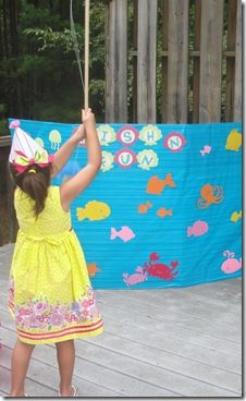 Little mermaid party,I like her games.  We did this at my daughters under the sea party.  I painted a board and sat behind it where no one could see me.  Each  partygoer threw the stick with clothes line and a clothes pin.I would hook a prize on the other side.  The Kid LOVe this