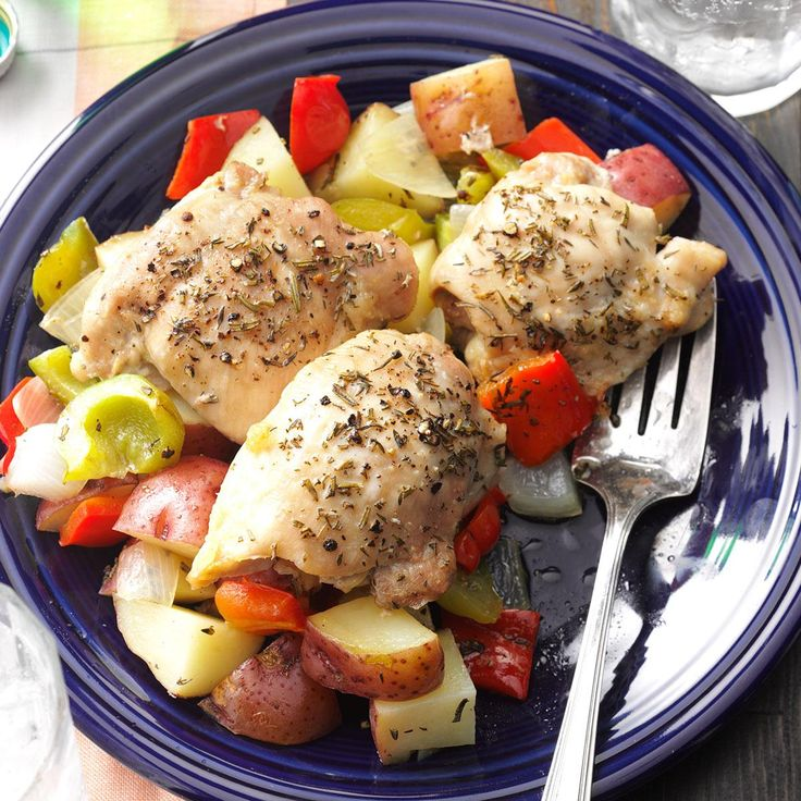 Roasted Chicken Thighs with Peppers & Potatoes Recipe -My family loves this dish! It looks and tastes like you fussed, but it is really simple to make. It uses healthy olive oil and fresh herbs from my garden.— Pattie Prescott, Manchester, New Hampshire