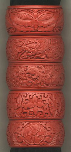 Wide red only cinnabar bracelets, Cinnabar is a type of red Chinese lacquer that was traditionally built up upon layre, then engraved. Cinnnabar usually red, sometimes paired with black ...