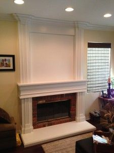 Floor to ceiling mantel covering an old brick fireplace surround ...
