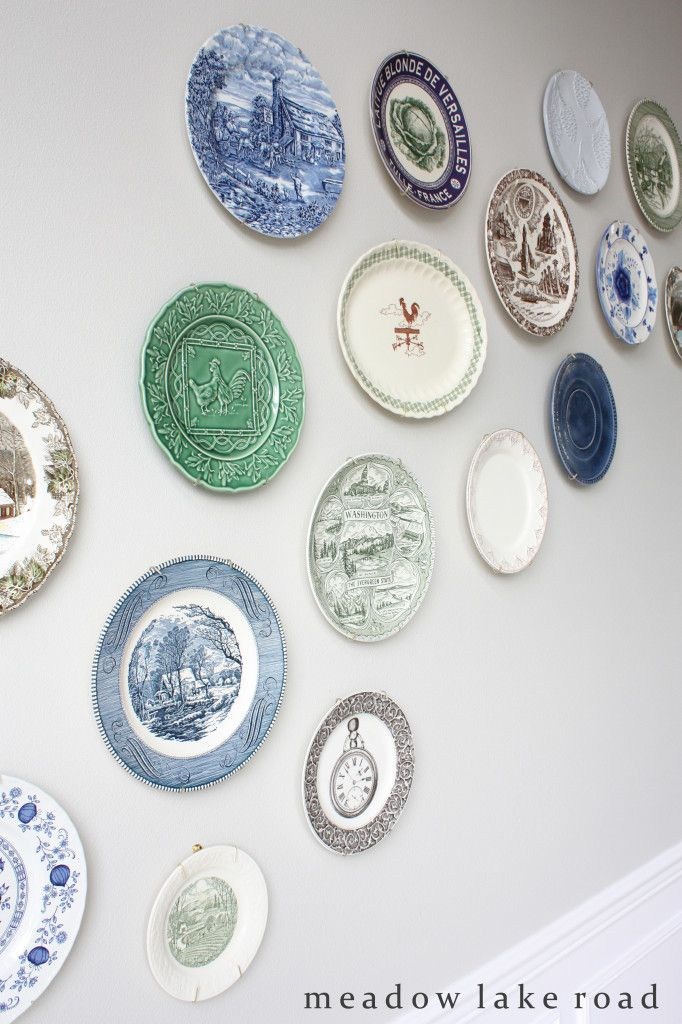 A collection of vintage-style plates grouped together on dining room wall   www.meadowlakeroad.com