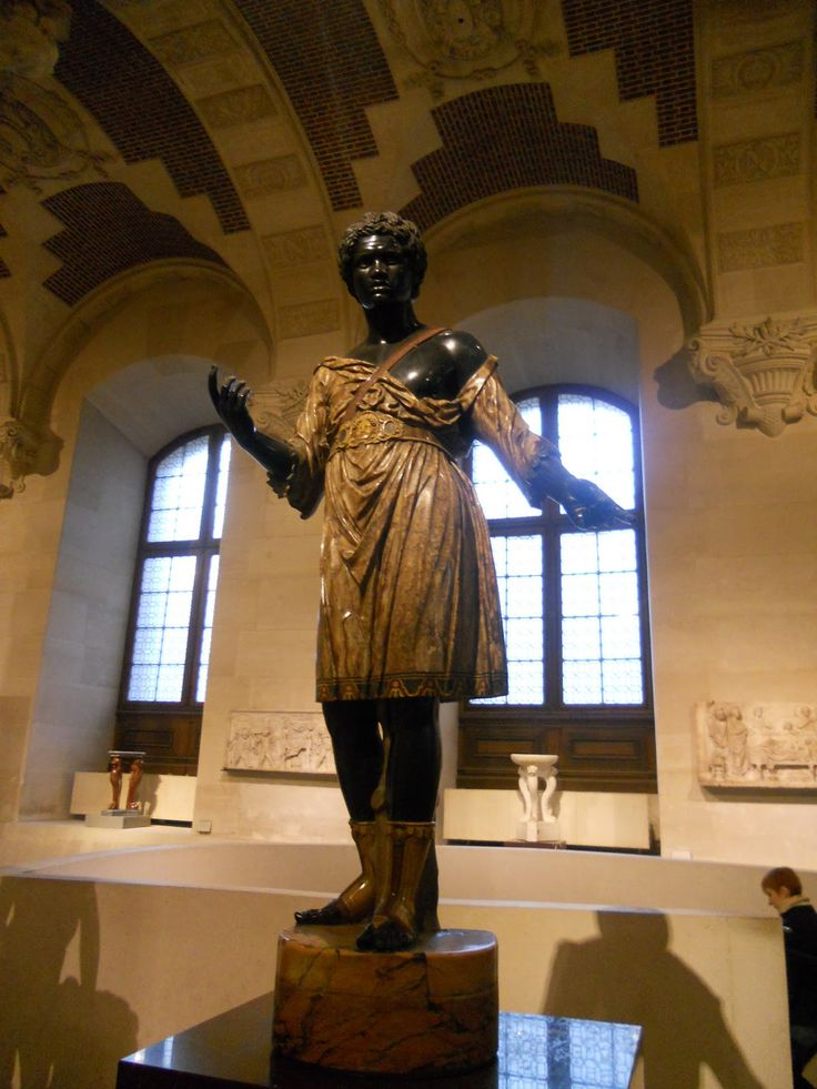 Black Roman statue in the Louvre museum.