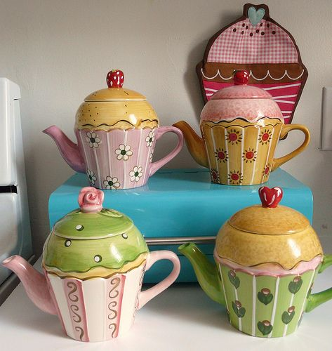 Cupcake Teapots! Shoot, now I want to collect desert shaped teapots...what a dilemma so many adorable teapots and only two eight foot shelves to display them on :(