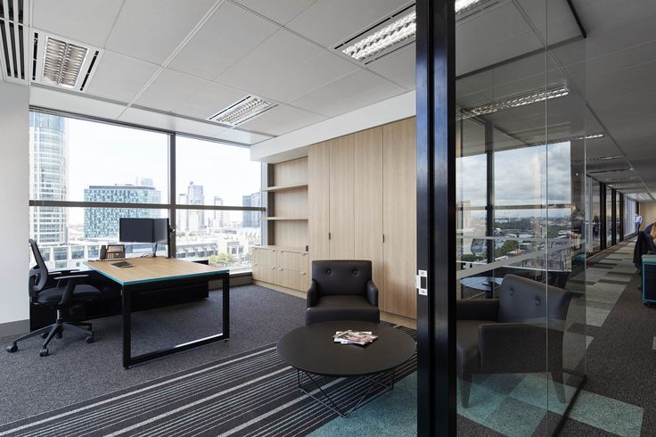 M2 Telecommunication - use of patterned flooring and glass for private office. By STUDIOMINT Melbourne Australia