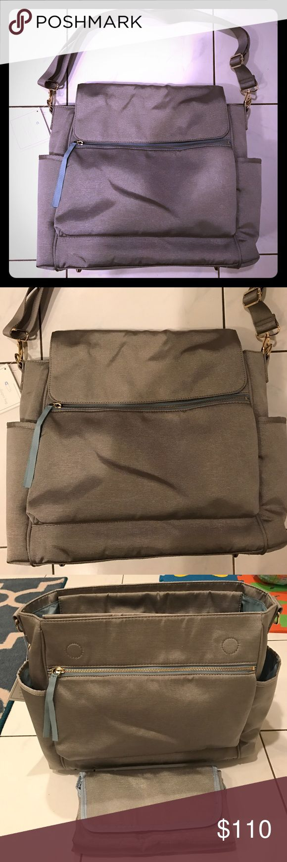 💕FLASH SALE💕BRAND NEW Pottery Barn Diaper Bag BRAND NEW WITH TAG Pottery Barn Diaper Bag - beautiful grey diaper bag with light blue interior accents & zipper pulls & gold hardware. Never used and in mint Condition. Comes with matching diaper changing pad. Tons of pockets as seen in photos. Adjustable strap as well as hidden straps to convert to a backpack. Magnetic closure for bag & changing pad. Last picture shows 3 slight marks in fabric but this is how I received bag. Retails for $159…
