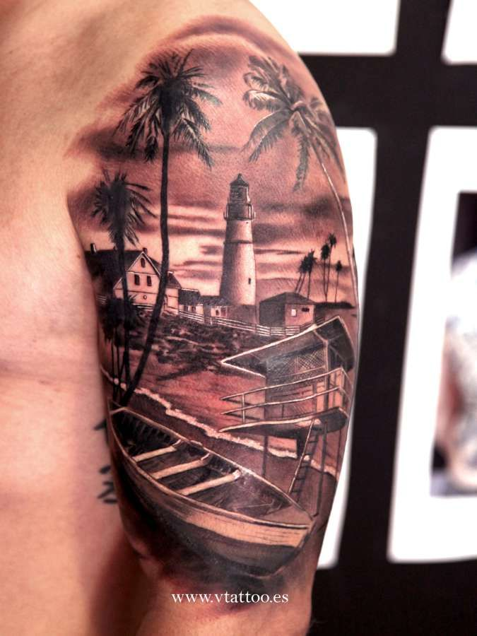 Beautiful beach with a lighthouse tattoo