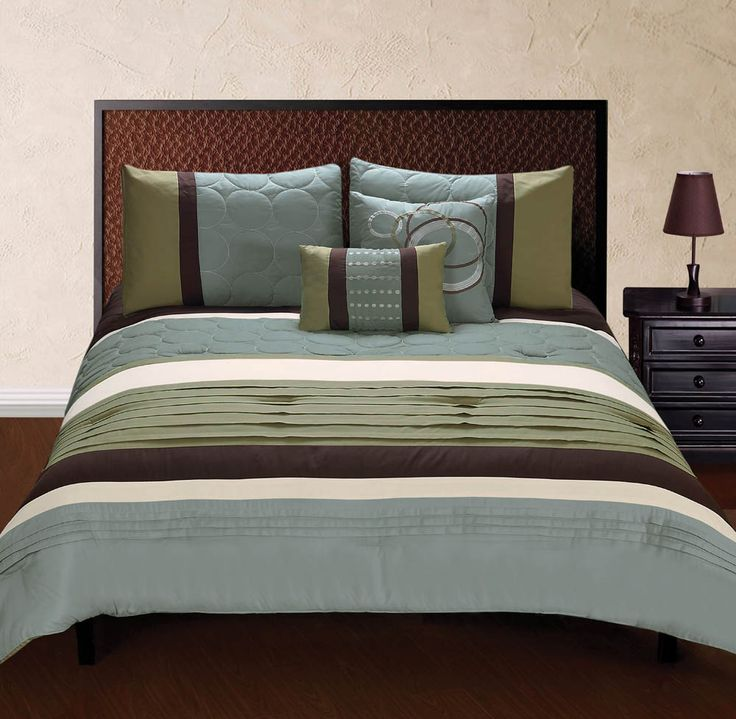 Rest in gorgeous color and texture with this queen size bedding set the luxe shades of green blue and brown come alive with a variety of textures and