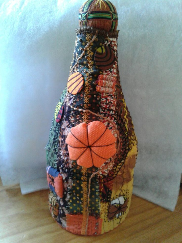Bushbabies Craftworks : Fabric bottle doorstop. Mixed media and embroidery.