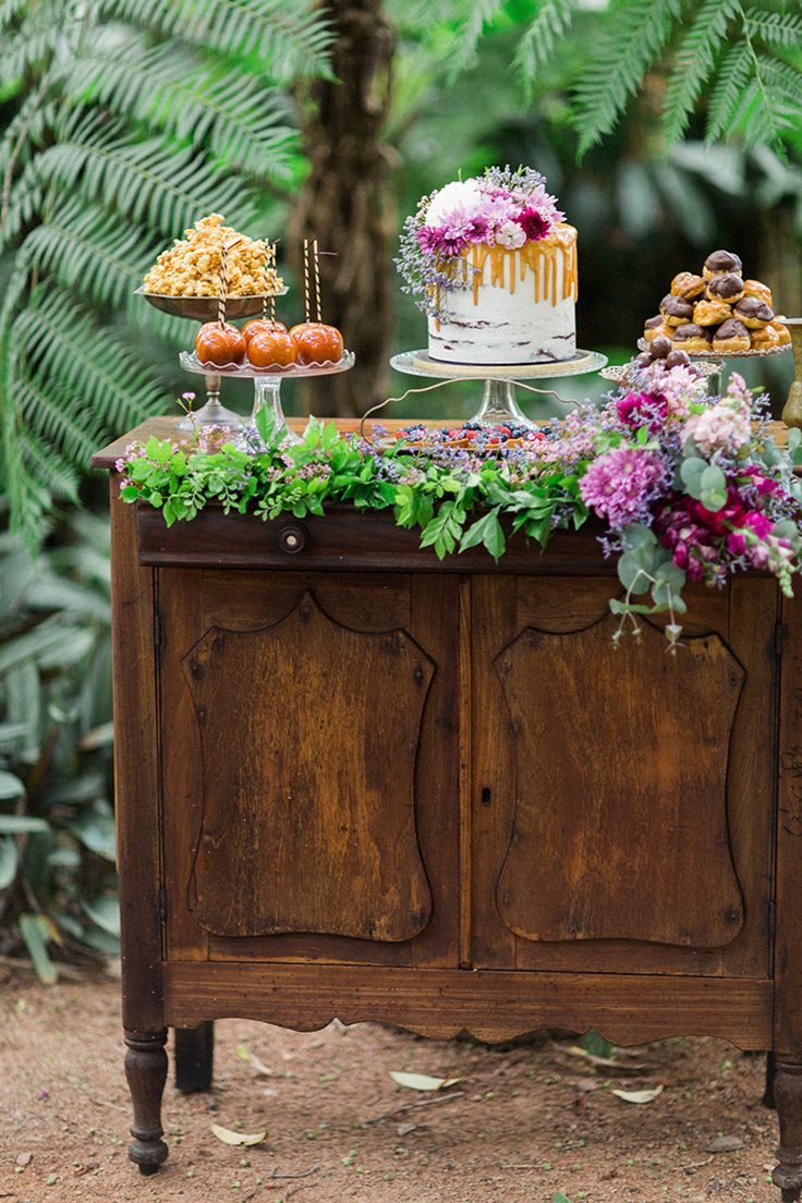 Wedding dessert display on vintage dresser  | Ricky Ebel Photography | See more: http://theweddingplaybook.com/vintage-floral-wedding-inspiration/