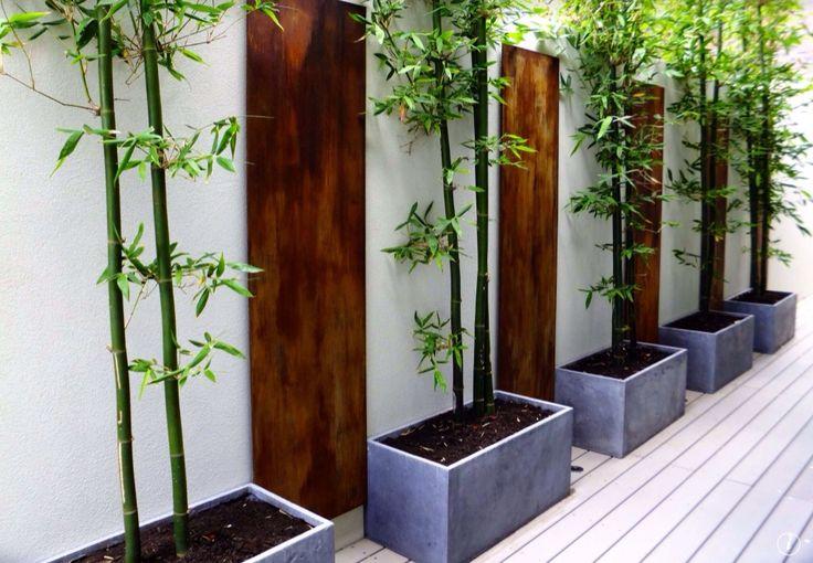 Contemporary Landscape/Yard with Concrete Habitat Rectangular Planter, Cali Bamboo BamDeck Slate Solid Composite Decking