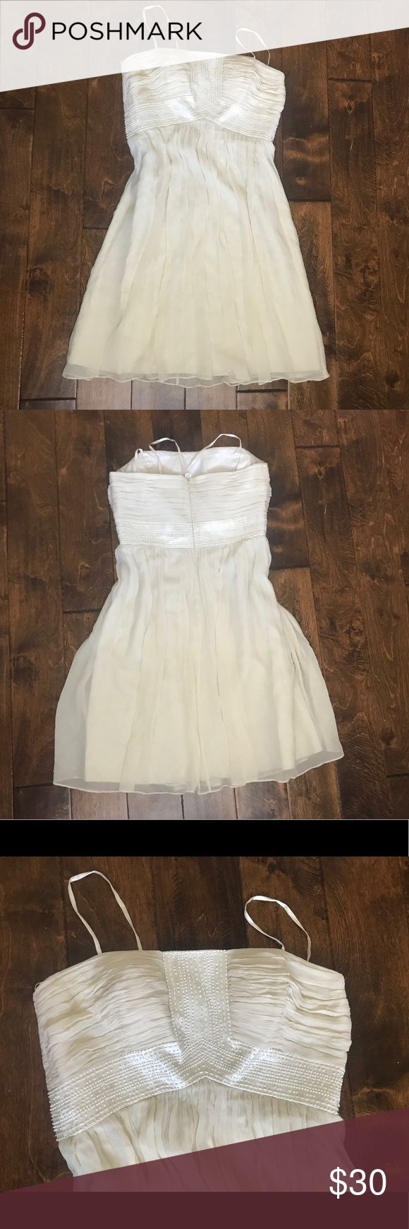 Maggy London formal dress Beautiful cream formal dress by Maggy London. Sz 12, 100% Silk. Used but still in great condition. No stains or rips. Reasonable offers welcome 🤗 Maggy London Dresses Midi