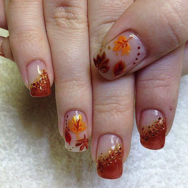 Falling leaves add a seasonal twist to negative space nail art.