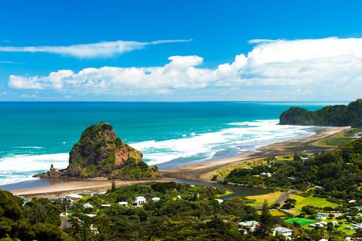 The west coast's Piha Beach is popular with surfers seeking powerful waves