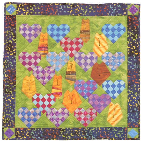 "Foundation-pieced kitties snuggle up with checkerboard hearts in this whimsical ""My Funny Valentine"" quilt by Janet Kime—the queen of cat quilts!"