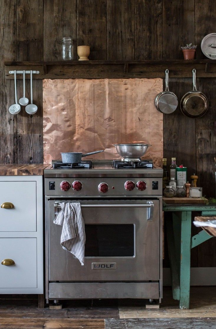 best 25 copper backsplash ideas on pinterest reclaimed wood a country house reinvented by jersey ice cream co cabin kitchenscottage kitchenscream kitchenscopper backsplashstove