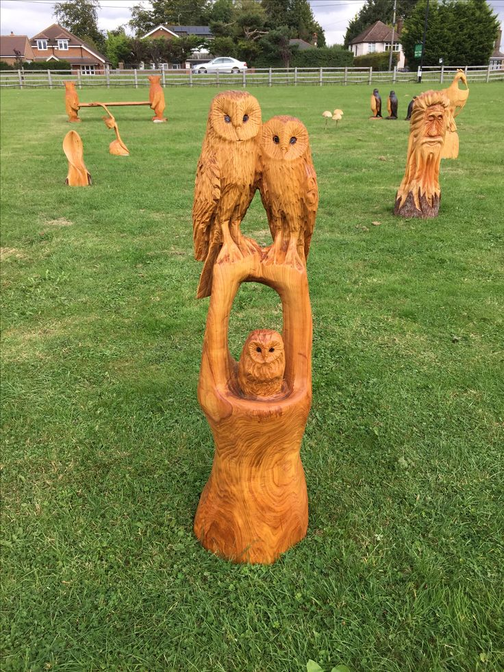 Chainsaw carved pair of owls and owlet out of cherry