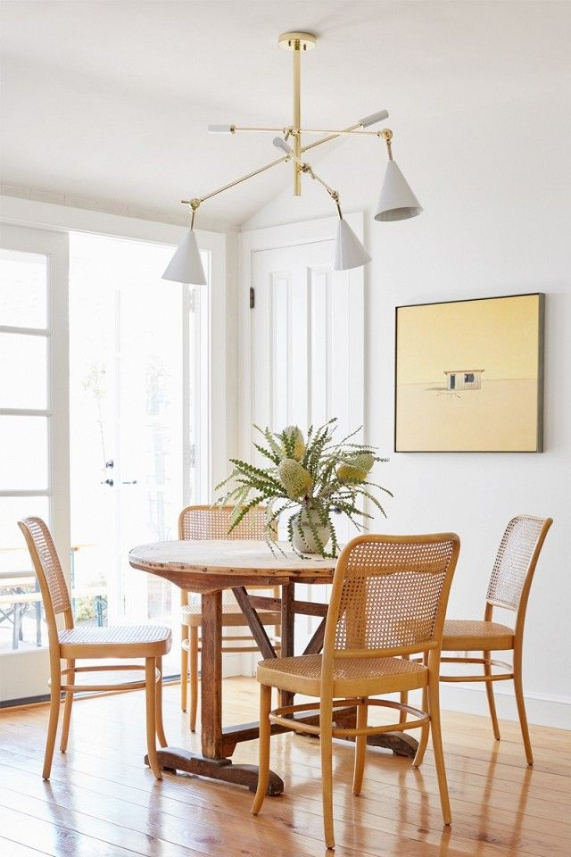 Laid-back dining space with wooden chairs, and a large pendant light