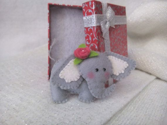 Elefant is a symbol of happiness, longevityand good luck! Share it with someone you love! This nice felt elephant brooch is completely hand stitched with a metal brooch pin on the back, which has been stitched on.  A nice gift for a loved one! Size:  4.5cm x 8cm (1.7 x 3.15) Gift box:  6cm x 8.5cm (2.36 x 3.35)  Felt brooch is made of felt and filled with soft holofiber to create volume. Handmade applique. Very soft and pleasant to the touch. Safety pin on the back side.  Cute felt elephant…