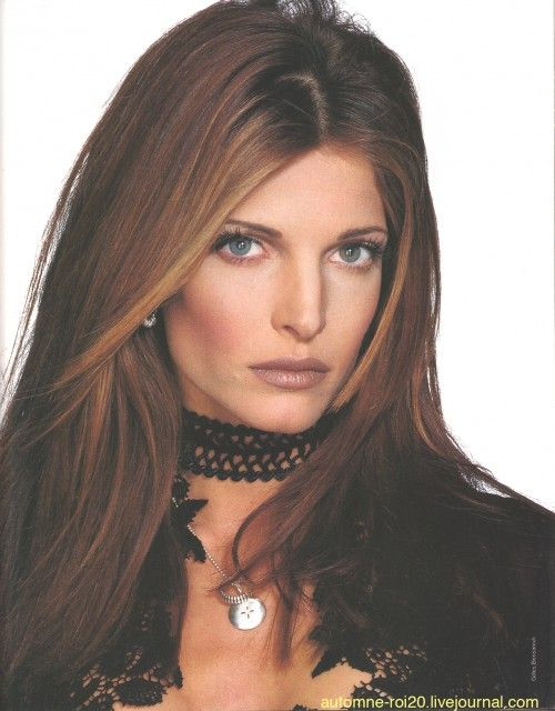 Stephanie Seymour rockin' the face framing highlights, brown lipstick on over-lined lips, contoured cheeks, nude eyes and pencil-thin brows.  AND, wearing the quintessential 90's bling: a black choker.  Love, Love, LOVE