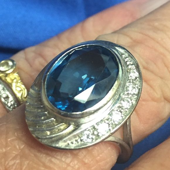 """💥FLASH 18k Vintage London Blue Topaz Diamond Ring 💥FLASH SALE💥True vintage 18K white gold setting has bezel set large Oval London Blue topaz and diamonds curving on one side, ending in a ribbed design. Stone measures 14mmX11mm, overall being 21mm X 16mm (24mm = 1"""" inch). There is some wear/scratches to the gold which can be polished out by a jeweler.  Price reflects that! Hallmarked """"750"""" usually a British hallmark for 18K gold. SIZE 6.5 easily. 💟***EXCLUDED FROM ANY Bundle Sale***💟…"""