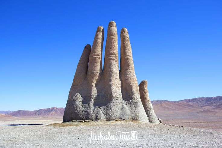 "The ""Mano del Desierto"", a large scale sculpture of a hand created by the Chilean sculptor Mario Irarrazabal to emphasize human vulnerability and helplessness. It is located 75 km south to the city of Antofagasta, on the Pan-American highway.  #manodeldesierto #atacama #desert #sculpture #hand #chile #chilean #panamericanhighway #travel #tourism #wanderlust"