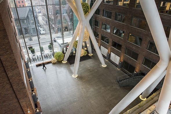 """The new building at Richmond and Peter entices passersby thanks to its cavernous, five storey (or 70 feet) atrium filled with soaring x-shaped delta frames. """"It's nice that it's almost an art installation in itself,"""" says property manager Alicia Scott of the Queen Richmond Centre (QRC) West. Though the frames..."""