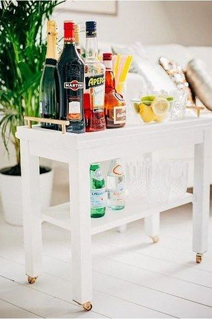 Turn the Nornäs side table into an elegant bar cart.   37 Cheap And Easy Ways To Make Your Ikea Stuff Look Expensive