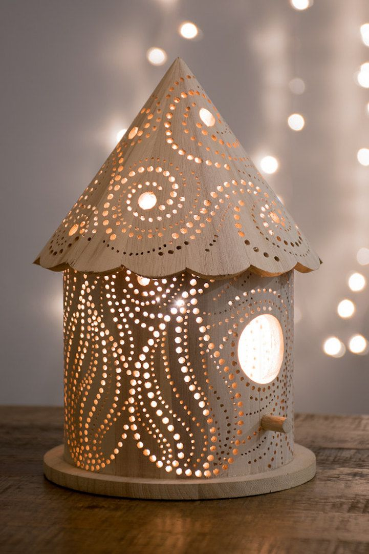 Intricate Wooden Lamps Offer A Beautiful Illuminated Guide Through Dark  Rooms