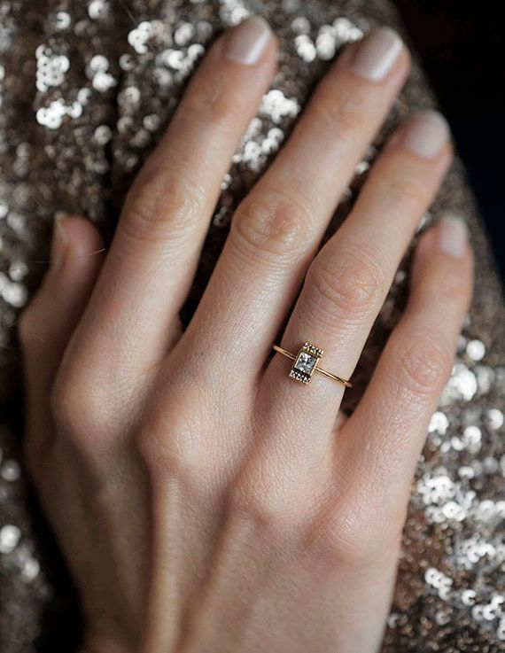 This dainty princess cut diamond ring: | 32 Impossibly Delicate Engagement Rings That Are Utter Perfection