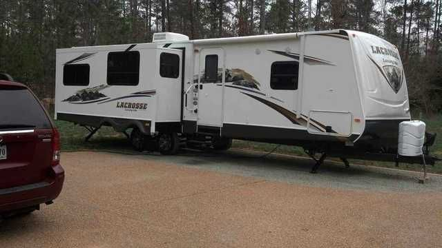 2012 Used Prime Time Lacrosse 322RES Travel Trailer in Virginia VA.Recreational Vehicle, rv, 2012 Prime Time Lacrosse 322RES, Model 322RES. This beautiful well appointed camper sleeps 8. The camper has all the luxuries of home offering a large side by side refrigerator, fireplace and 2 comfortable love seats and and wrap around kitchen counter, corner shower and queen size bed. This camper also has plenty of storage space. We are selling because we do not use this enough. We have only towed…