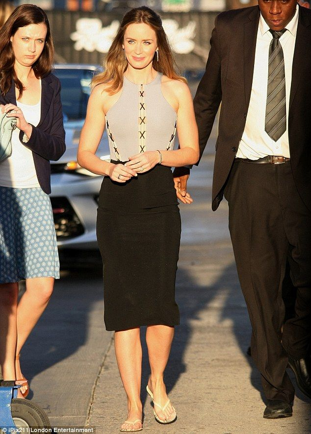 Natural beauty: Emily Blunt showed she's no slave to fashion by wearing flip-flops with her designer dress for an appearance on Jimmy Kimmel Live on Tuesday