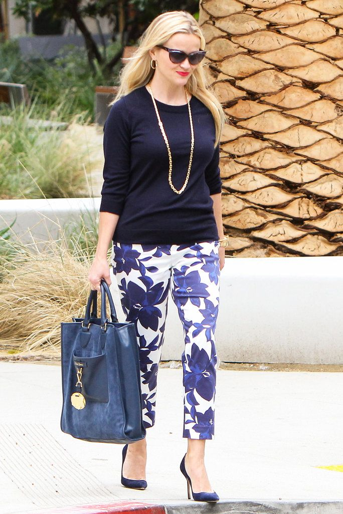 Reese Witherspoon was spotted in Draper James trousers, which she paired with coordinating navy accessories.