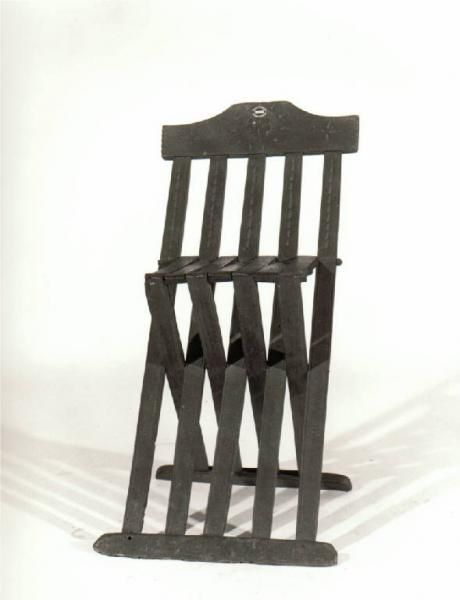 FOLDING CHAIR. Maker from Tuscany; beechwood;1490-1510c; dimensions 84 cm (height), 37 cm (width), 29 cm (depth); displayed at Morando Bolognini Museum, Sant'Angelo Lodigiano (prov. LO, Lombardia, Italy)