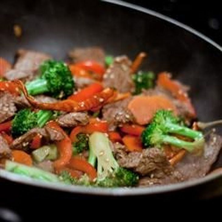 Quick Beef Stir-Fry Recipe Main Dishes with vegetable oil, beef sirloin, broccoli florets, red bell pepper, carrots, green onions, minced garlic, soy sauce, sesame seeds