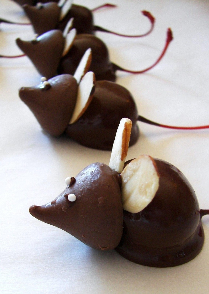 Kiss, chocolate covered cherry, almond slivers