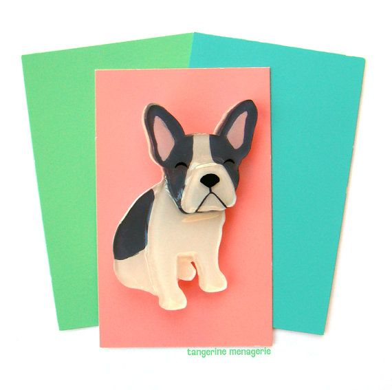 This little French Bulldog brooch (who could also double as a Boston Terrier) is made of four hand-painted layers of plexiglass, finished off