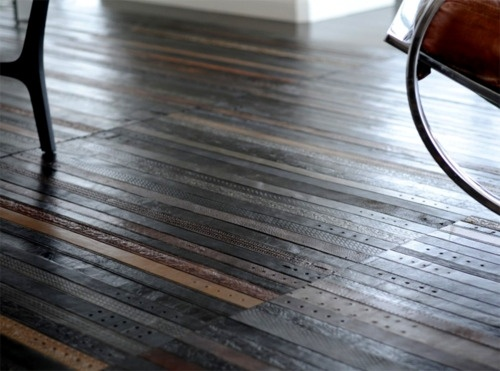 Recycled leather belt flooring. Whats more manly then leather belt floors?