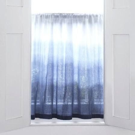Dip Dyed Ombre Curtains is a photo craft tutorial that explains how to slowly add dye to a white curtain giving it an ombre effect.