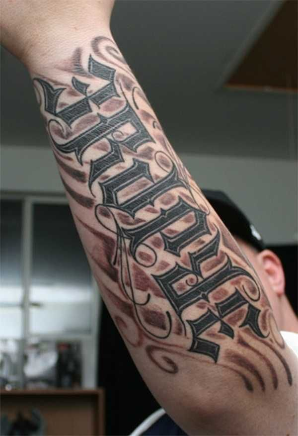 tribal-lettering-tattoo-design-on-arm ~ http://heledis.com/the-lettering-tattoo-design-becomes-a-new-trend-now/