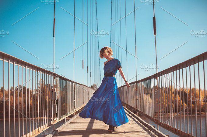 Woman in blue dress by MarinaMassel on @creativemarket