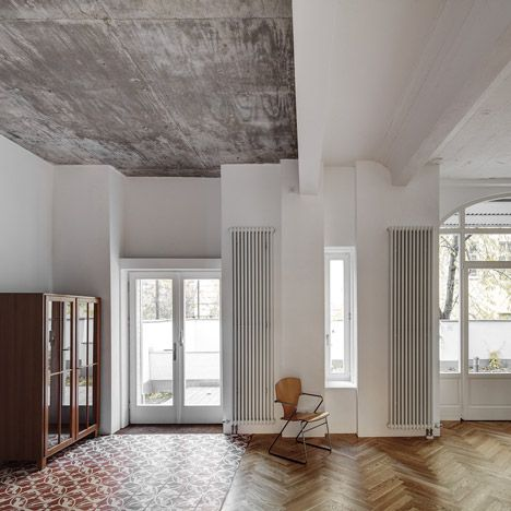 Local architects Marc Benjamin Drewes and Thomas Schneider teamed up to design the apartment for a couple and their children, creating two bedrooms, a bathroom and an open-plan living room and kitchen.