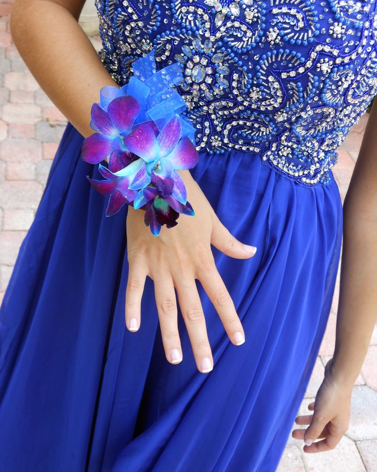 My blue orchid corsage for prom received so many compliments! I definitely recommend getting one if you have a royal blue or purple dress!