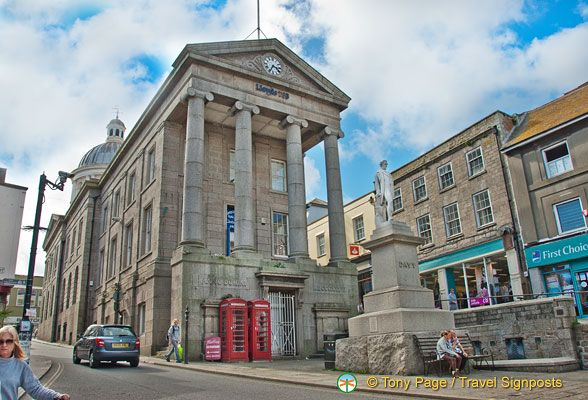 Lloyds bank in the centre of Penzance town, in front stands Humphrey Davy statue