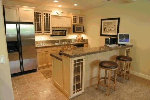 Great flooring, counter tops, wall color, & cabinets... Wish there was a way to put in a breakfast bar like this...