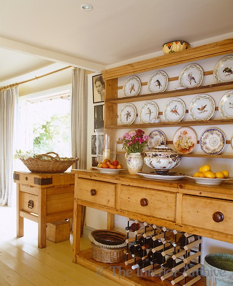 In the kitchen a massive Welsh dresser displays a collection of decorative plates