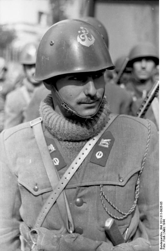 Italian  midshipman belonging to the X MAS, a special Navy corp created for dangerous missions and special ops that subsequently become, at the end of the war, almost Junio Valerio Borghese private army. They were often used for the antipartisans war and there are various reports about their cruelty and fanaticism. Nettuno.Rome.  March 1944.