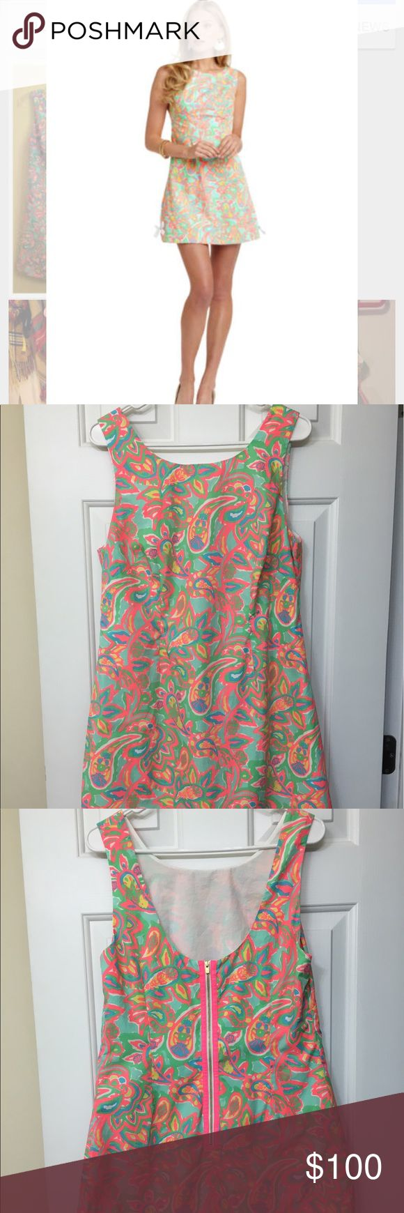 Lilly Pulitzer Make A Splash Delia 12 Authentic and in excellent preowned condition. Worn only one time for an event. You cannot see in the photos but this dress does have two solid white side bows. The dress is double lined and zips up the back. Shipped immediately from a smoke free home. Lilly Pulitzer Dresses Midi