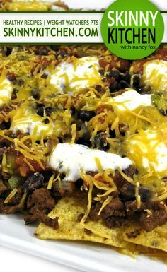 Skinnylightful Nachos Supreme. These layered and baked nachos use all skinny ingredients and are fantastic! Each serving has 207 calories, 5 grams fat and 5 Weight Watchers POINTS PLUS. https://www.skinnykitchen.com/recipes/skinnylightful-nachos-supreme/