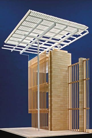 """Renzo Piano's model for the Art Institute of Chicago's new wing, showing its limestone wall, glass curtain and """"flying carpet"""" roof"""