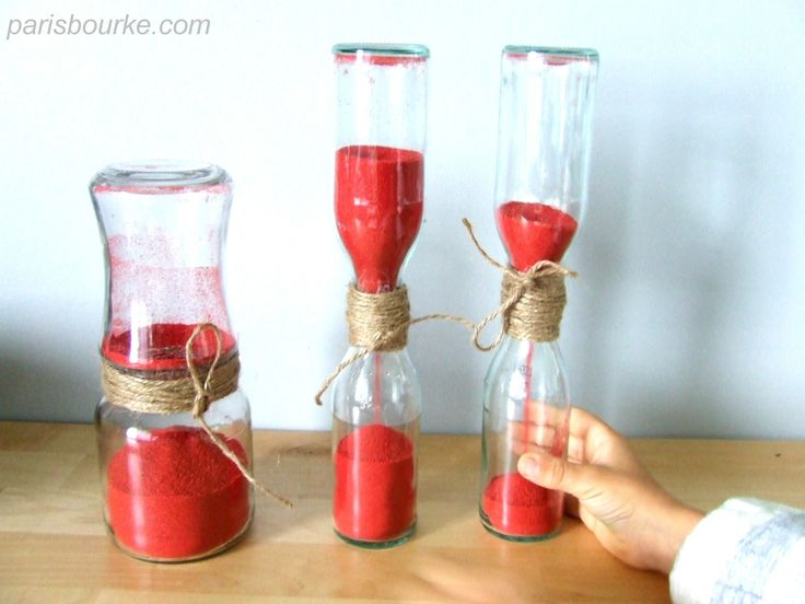Make your own hourglass out of 2 jars, a lid with a hole, sand, tape, and ribbon or twine.